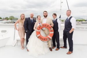 Wedding photo of bride and groom on boat