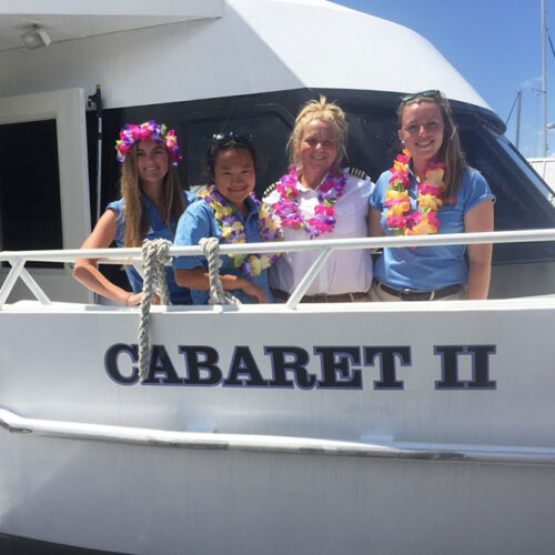Four women standing on the deck of Cabaret II