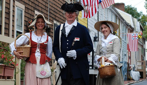 three tour guides in colonial attire