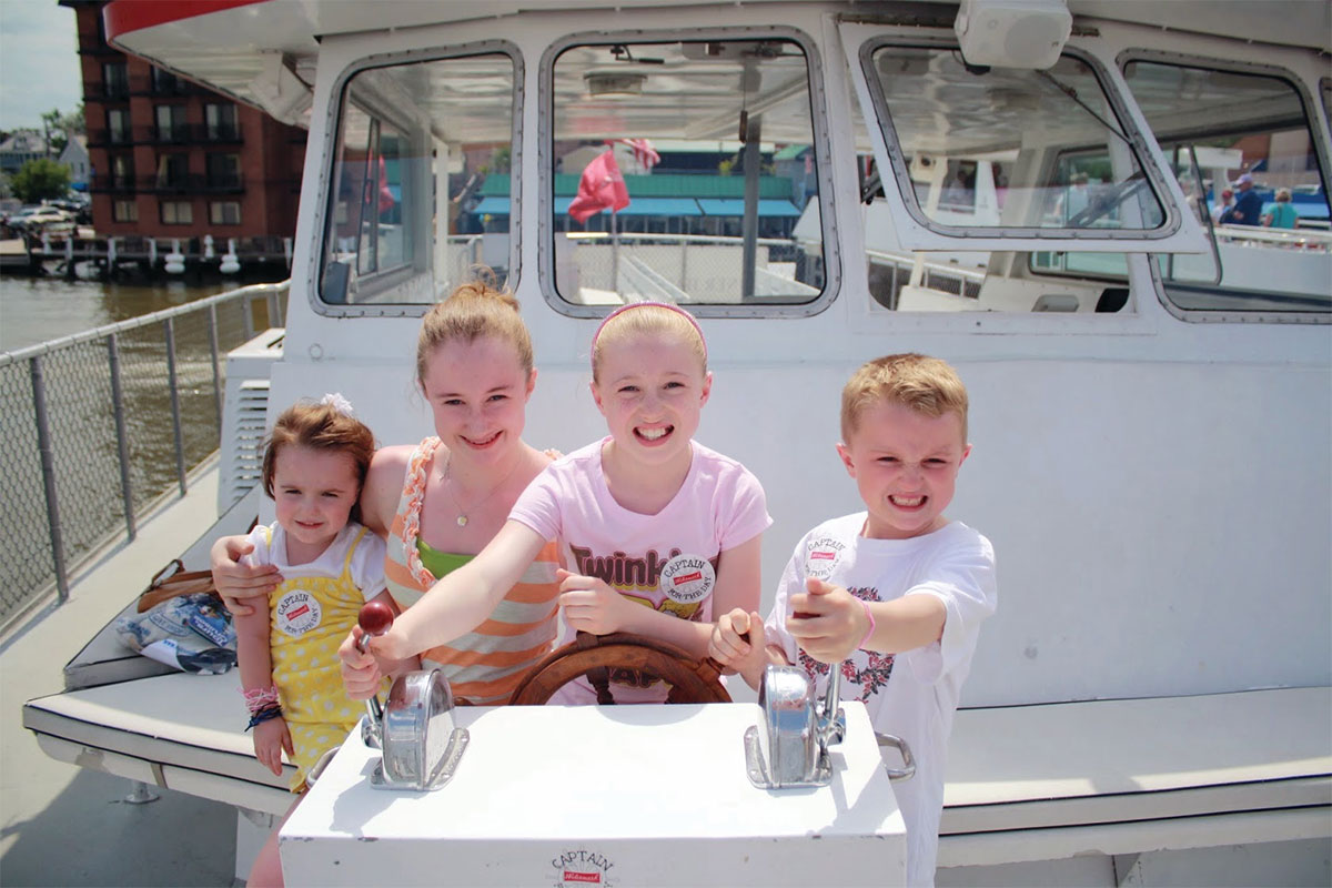 Four Children on the deck of a yacht